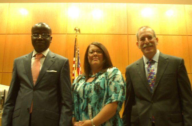 Ivory Coast Judge Ehounou Manlan, Colonie Clerk of the Court Julie Gansle and Colonie Town Justice Andrew Sommers meet at the Colonie Public Safety Center on Thursday, Sept. 1. 