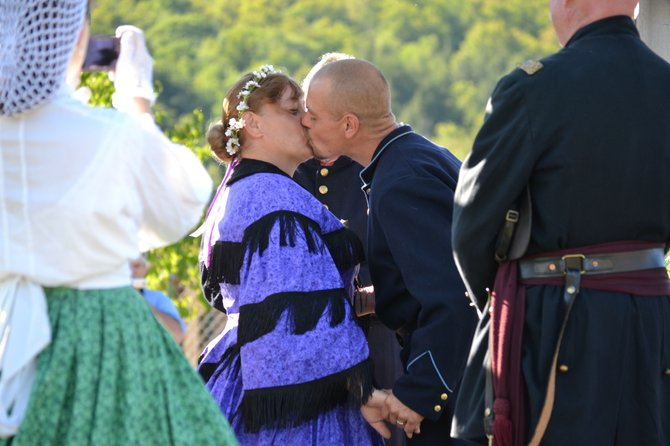 The happy couple celebrates their union with a kiss.