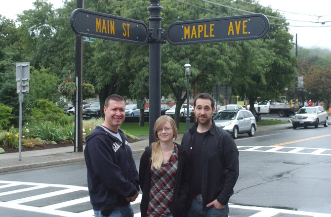 The team behind Mio Vino, a wine bar and bistro that's aimed for a mid- to late-October opening, standing at the corner of Main Street and Maple Avenue in Altamont, where the restaurant will be located. From left: Michael Giorgio, Siobhan Spencer and Chef Evan Sloan.