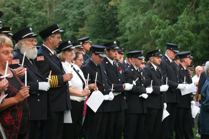 Bethlehem firefighters and citizens gathered in the Bethlehem Firefighters and EMS Park in Slingerlands on Sunday, Sept. 11, the tenth anniversary of 2001 terrorist attacks.