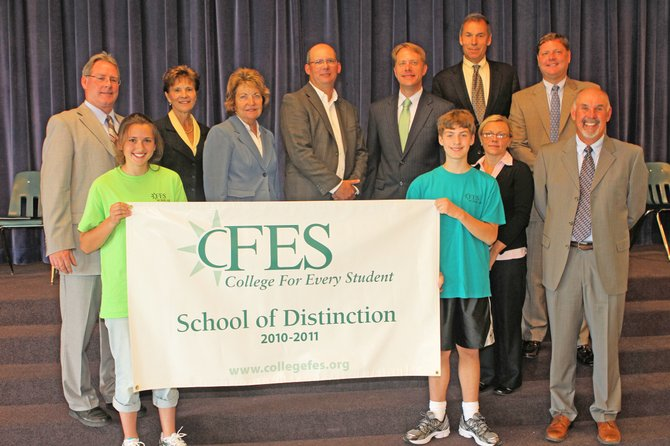 "Ticonderoga Middle School has been named a ""School of Distinction"" by the College for Every Student program. Pictured are, back from left, Ti Middle School Principal Bruce Tubbs, Assemblywoman Teresa Sayward, state Sen. Betty Little, Ti school board member Mark Russell, Deputy Assistant Secretary for Rural Outreach in the U.S. Department of Education John White, CFES Director Rick Dalton, Ti Superintendent John McDonald; front, student Jamie Cox, student Samuel Shelmidine, Ti guidance councilor Samantha Wells and Steve Boyce, CFES program director for Ti schools."