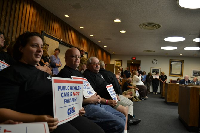 People protesting the privatization of home health care in Clinton County filled the legislative chamber at the Sept. 14 meeting.