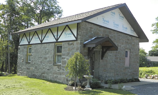 The exterior of the old Nunnery School on Nunnery Road as it looked in mid-August when owner Heather Bruno-Sears was in the middle of replacing the roof and windows. The roof is being done in an English cottage-style using ornamental Hemlock wood.