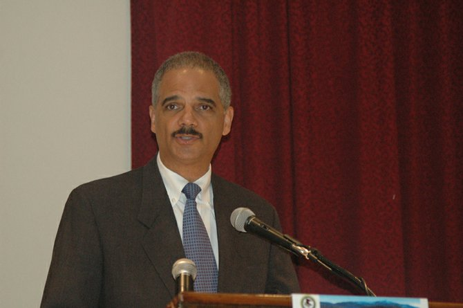 U.S. Attorney General Eric Holder speaks to law enforecment officials from the United States and Canada at the Crowne Plaza in Lake Placid Sept. 14.