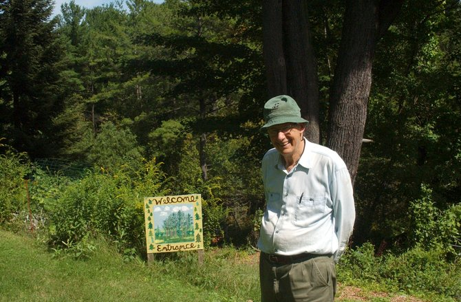 John Abbuhl stands at the entrance to the Pine Hollow Arboretum in Slingerlands. He&#39;s made over 3,200 plantings over the decades in the preserve, which today has species from all over the globe for the public&#39;s enjoyment and enrichment. The Arboretum is holding a unique concert on Sept. 25 to benefit victims of Tropical Storm Irene.
