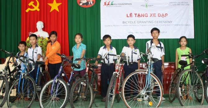 Children in Vinh Long province in Vietnam with bicycles provided by the Pedals for Progress foundation. The group collects bikes to send overseas to poor and rural areas, where they can make a big difference. Charlie Hughes, a Delmar resident, is organizing a local drive to be held Saturday, Sept. 17.