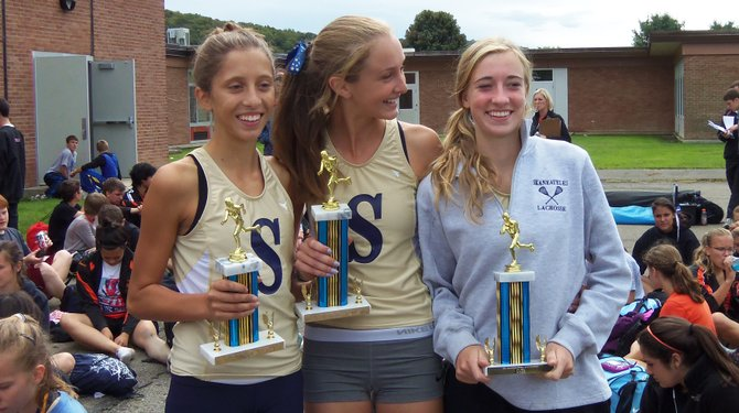 Skaneateles girls cross country runners would sweep the top spots at Saturday's Maine-Endwell Invitational. Madeline Adams, center, won the varsity race, with Ellis VanSlyke (right) the JV race winner and Morel Malcolm (left) third in the varsity contest.