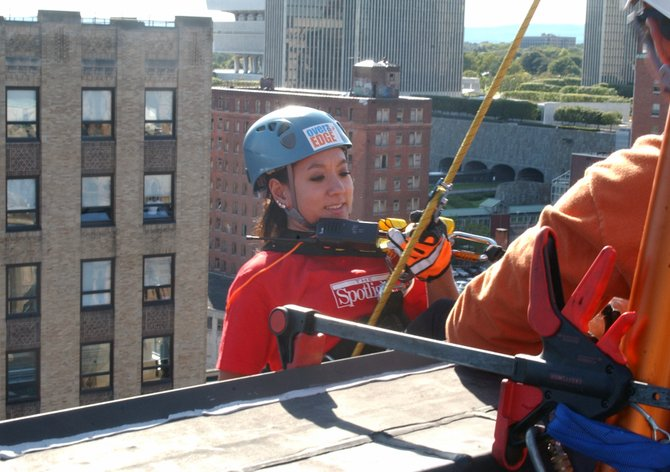 Spotlight reporter Alyssa Jung rappelled down the side of the Crowne Plaza in the Over the Edge fundraiser for the Special Olympics on Friday, Sept. 16.