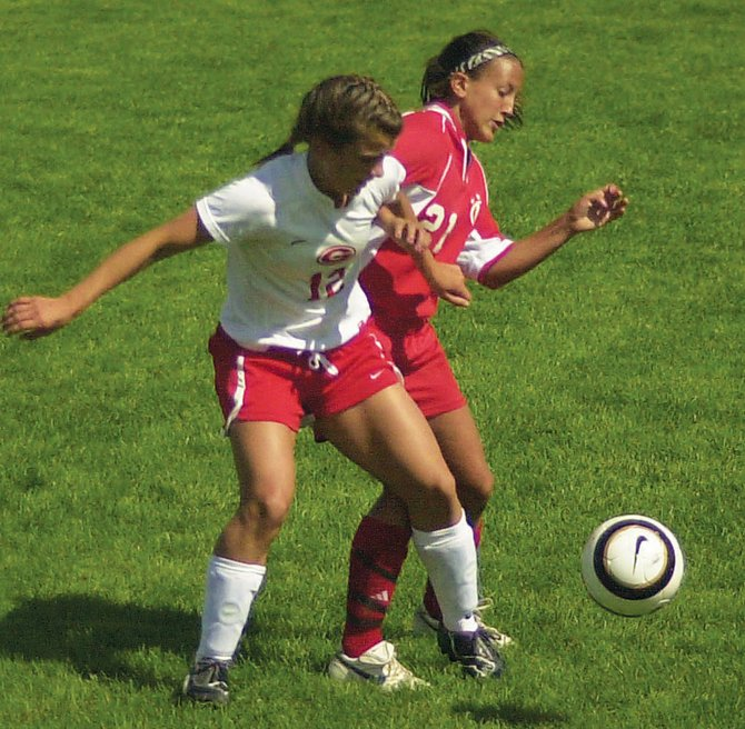 Guilderland's Laurie Knapp, left, battles Niskayuna's Sophia Constantine for the ball during a Suburban Council girls soccer game Saturday, Sept. 17, in Guilderland.