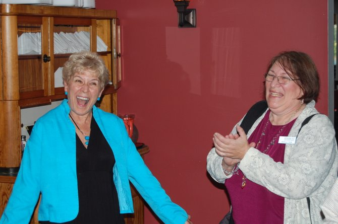 Beckie O'Neill was named Woman of the Year at a surprise party Sept. 14. O'Neill is owner of Managing Wellness and a counselor at St. Joseph's Addiction Treatment & Recovery Center.