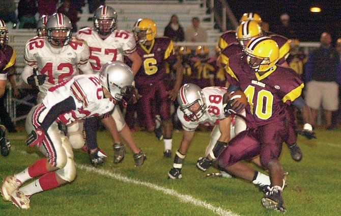 Colonie tailback Jason Gayle (40) tries to cut past a Niskayuna defender during last Fridays game. 