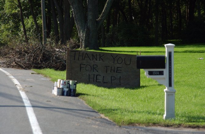 A sign thanking volunteers and emergency responders stands at the edge of a Rotterdam Junction residents front yard last week.