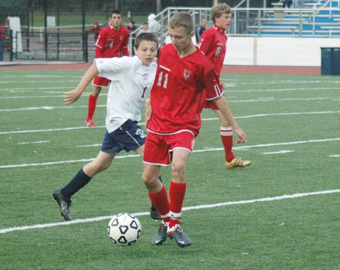 Austin Burl of Beekmantown gets past AuSable Valley's Riley Taylor Sept. 19. Burl had three goals in the Eagles 8-0 win against the Patriots.