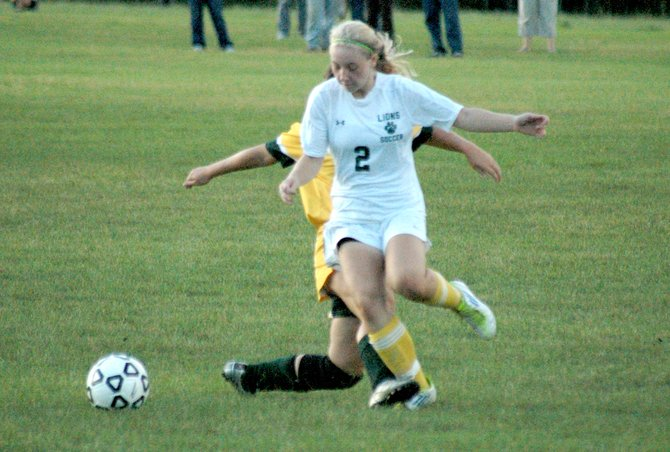 Elizabethtown-Lewis striker Kylee Cassavaugh gets past a defender.