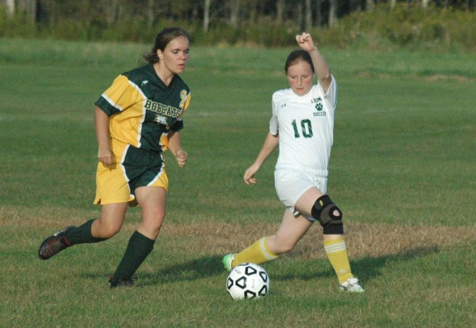 Lindsay Bruce of northern Adirondack goes for the ball along with Kristen Napper of Elizabethtown-Lewis.