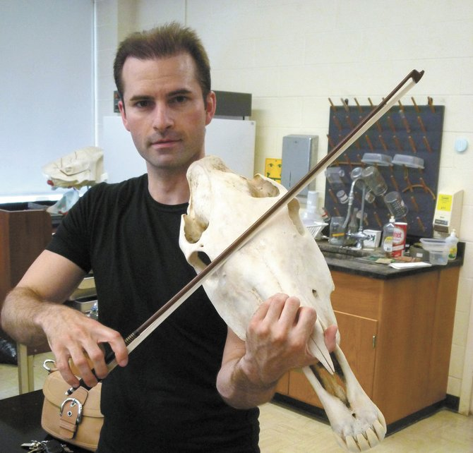 "Violinist Joshua Diesti tries to imagine how Leonardo's viola da braccio might have been played. ""Horsing Around with Leonardo da Vinci,"" will be held at 7 p.m. on Friday, Sept. 30, in the Cazenovia College Equine Education Center's Great Hall."