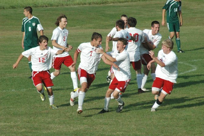 Willsboro's Clayton Cross is mobbed after scoring the second goal for the Warriors in their 3-1 defeat of Chazy Sept. 21.