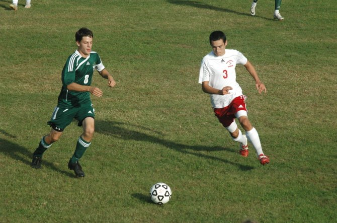Chazy's Nolan Rogers and Willsboro's Nick Arnold chase down the ball.