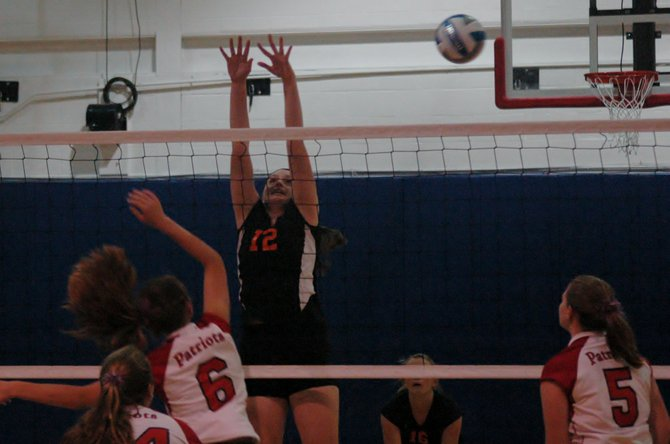 Plattsbugh High's Katie Cantwell blocks a kill attempt.