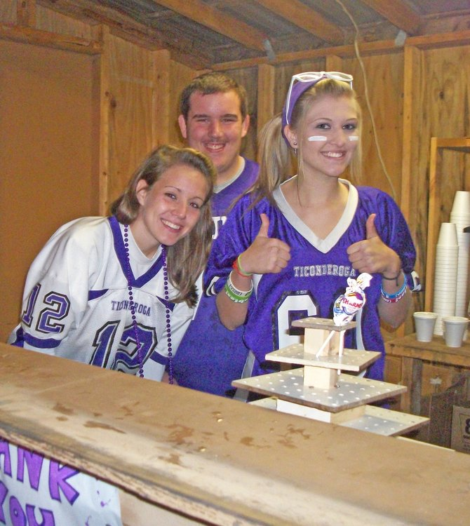 Paige Hughes, Steven Bussey and Samantha McLaughlin sell refreshments during a Ticonderoga High School football game. The Sentinels will host their homecoming game and hall of fame induction Oct. 7.