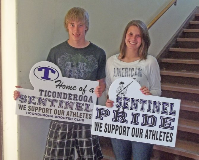 The Ticonderoga Booster Club has purchased Sentinel Pride signs for all local businesses in an effort to increase the show of school spirit throughout the community. Displaying the signs are student representatives Jay Hebert and Jaelyn Granger.