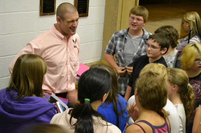 Tom Murphy, a mixed martial arts fighter turned public speaker, is mobbed by fans at Johnsburg Central after his anti-bullying talk Sept. 23.