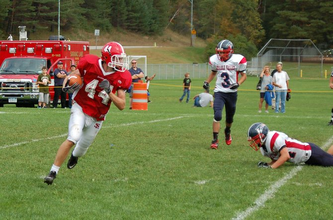 Red Storm junior Mike Burpoe runs the ball after catching an interception.