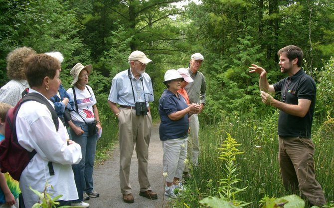 "Colgate University Professor of Biology, Eddie Watkins, right, educates residents about different species of fern found in the area during a Cazenovia Preservation Foundation sponsored walk, ""Native Ferns and their Propagation,"" Aug. 27 at Nelson Swamp Unique Area."