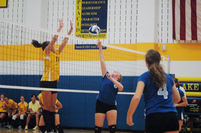 Lake Placid's Serina Hayes tries to block Peru's Sam Banker.