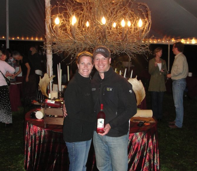 "Owera Vineyards Director of Operations Ben Reilley, right, poses with his wife, Shioban, and a bottle of Owera's NYS 2011 Wine and Food Classic double-gold award-winning ""Cazenovia Blush"" during the Taste of Cazenovia, Sept. 21."