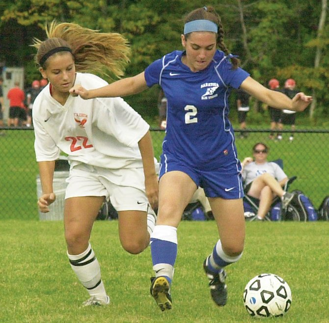 Saratoga's Elizabeth Adams (2) stays a step ahead of Bethlehem's Stephanie Dootz during a Sept. 22 Suburban Council game in Delmar. The Blue Streaks played the Lady Eagles to a scoreless tie.