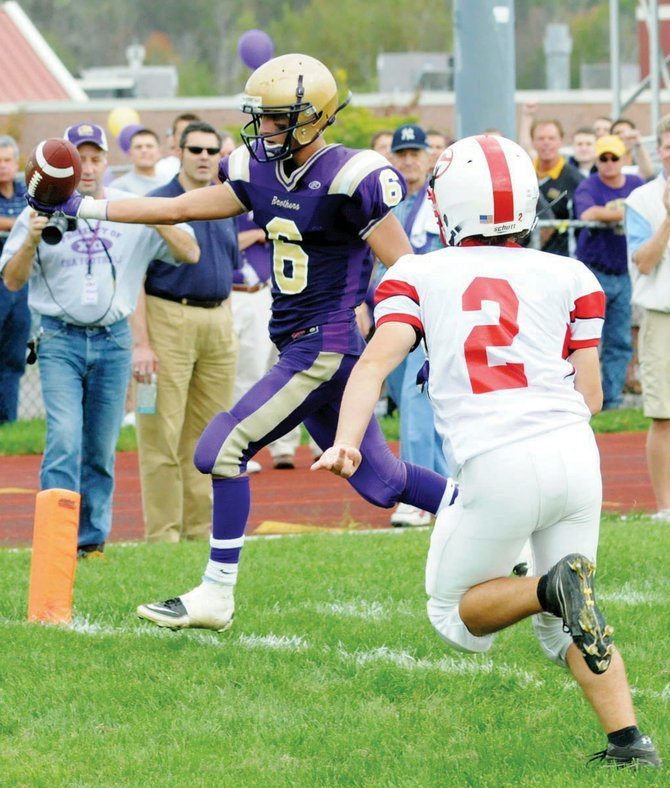 Christian Brothers Academy's Pete Luizzi scores the touchdown that pulled thr Brothers within a point of Guilderland in last Saturday's Empire Division game in Colonie. Luizzi then threw the two-point conversion pass that gave CBA a 26-25 win.