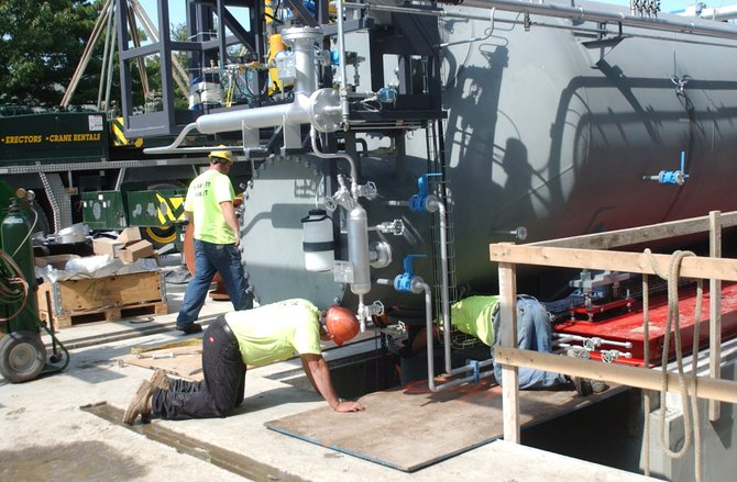 Workers install a new turbogenerator at the Albany County Sewer District's North Plant in Menands on Wednesday, Sept. 21. The new waste-to-energy project is expected to save the county over $400k per year.