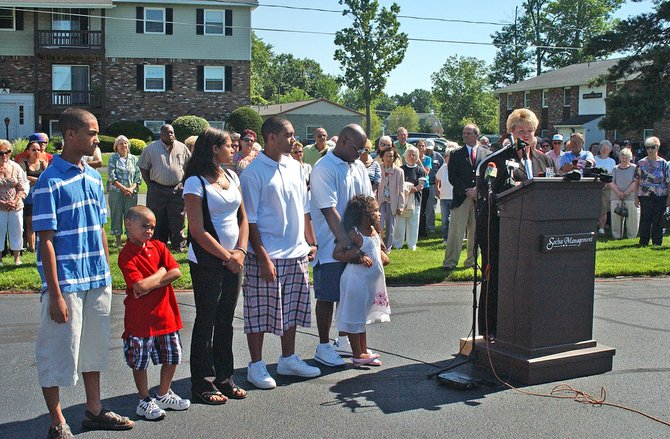 Deana Tope stands with her inter-racial family during a press conference at Shady Lane Apartments last July.
