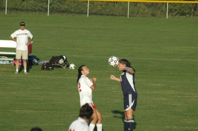 Brook Reid of Lake Placid hits the soccer ball off her head.
