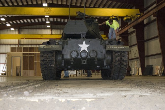 The M-47 Patton Tank leaves a trail of dirt were the tracks rolled after being driven into the museum.