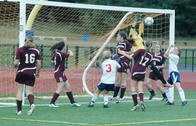 Norteastern Clinton Defenders Eliza Chevalier, Abby Miller, Erica Sorrell, Michaela McDonough and Aliie Cartier defend the goal along with keeper Celine Bouvier.