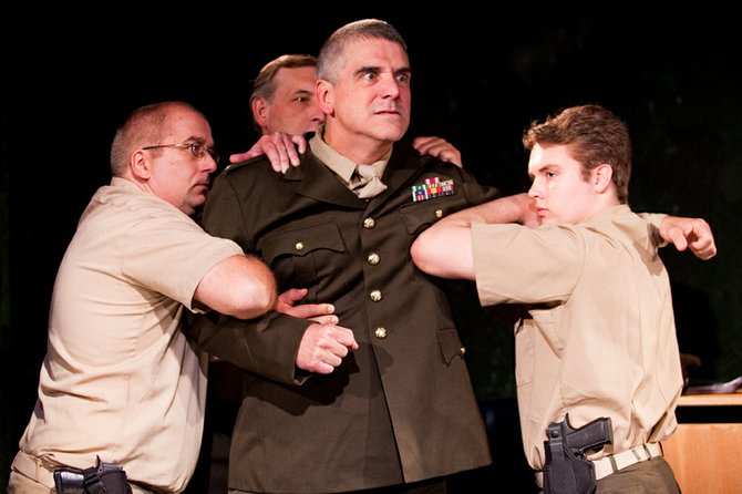 "Col. Jessup (Joseph Pierce) is restrained by the MPs in ""A Few Good Men,"" being staged through Oct. 1, at the Fire & Ice Banquet facility at The Locker Room Sports Bar, 528 E. Hiawatha Blvd., on the North Side."