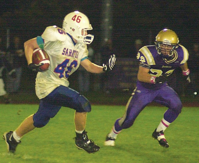 Saratoga's Dan Rittenhouse (46) tries to get past CBA's Nick Gentile during a Sept. 30 Empire Division game in Colonie.