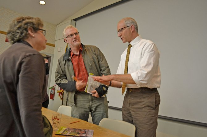 Part-time Adirondack resident Sandi Lewis chats with Brian Mann and Paul Hai following a discussion on towns in the Park Sept. 30.
