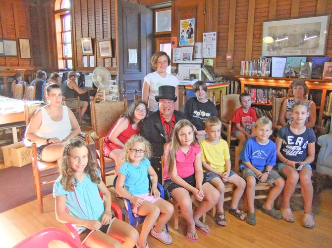 Thanks to a grant from Stewart's Shops children enjoyed the magic of Ron Cain in his Magical World Tour at the Sherman Free Library in Port Henry recently.  Each child also received a book to keep. The library is now conducting a fund drive.