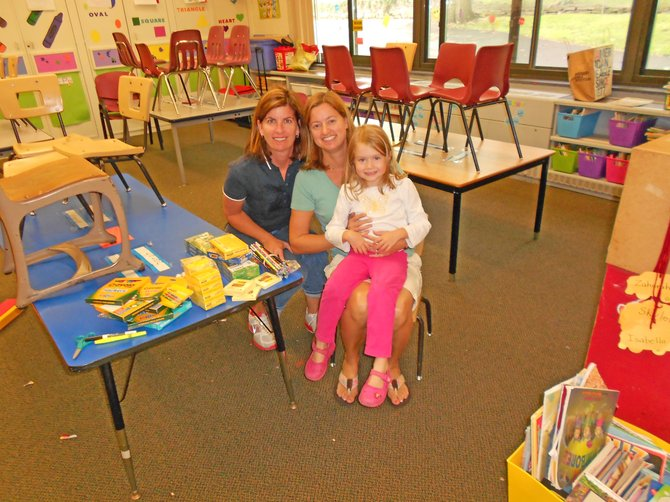 Schroon Lake teacher Christine Gonyeau, left, delivers school supplies to MacArthur Elementary School in Binghamton. Accepting are Liz Georgia, a MacArthur teacher and Gonyeau's sister, and her daughter, Logan.