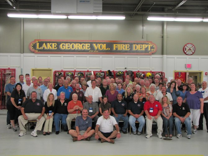 Members of the State Benefits Summit and the National Volunteer Fire Council pose for a group photograph in the Lake George fire station after a dinner hosted Sept. 27 by local firefighters.