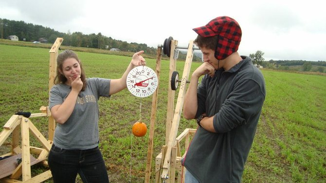 Randi Bassik, left, and Tobey Betthauser, were among members of the State University of New York at Plattsburgh Physics Club who came together last weekend at the annual Vermont Pumpkin Chuckin' Festival in Cambridge, Vt. The SUNY Plattsburgh team took home first place in the competition.