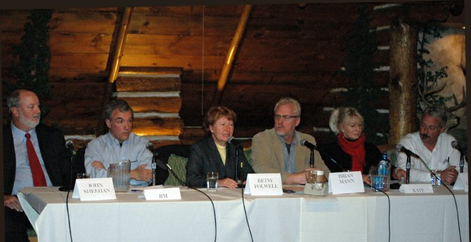 Panel members discuss the economic future of the Adirondack Park Oct. 5 at the Northwoods Inn in Lake Placid. From left are: John Sheehan, of the Adirondack Council; Jim Herman, of Keene; Betsy Folwell, of Adirondack Life magazine; Brian Mann, of North Country Public Radio; Kate Fish, of the Adirondack North Country Association; and Jim LaValley, of Adirondack Residents Intent on Saving Their Economy (ARISE) in Tupper Lake.