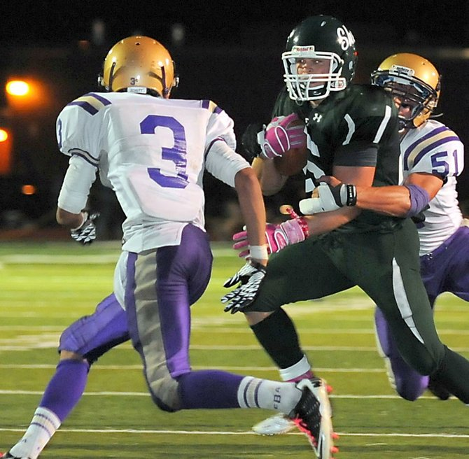 Shenendehowa running back Tony Fusco tries to dodge a Christian Brothers Academy defender while being hit from behind by another during an Oct. 8 game in Clifton Park.