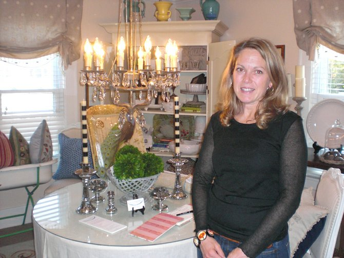 Elan Interiors Home Boutique owner Charity Swanson Buchika showcased her many home goods during an open house Thursday, Oct. 6.