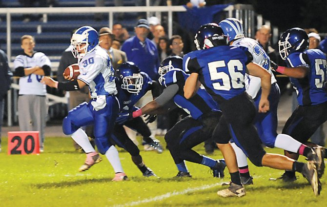 Shaker's Kyle Bernard (30) breaks free for a big run during an Oct. 6 Liberty Division game at LaSalle.