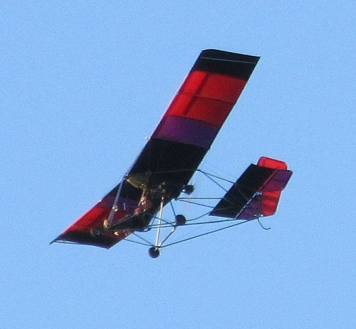 LAST FLIGHT — An ultralight aircraft, believed to be piloted by Paul J. Van Brunt, flies over the Warrensburgh Farmers' Market at 5:45 p.m. Friday Oct. 7. Van Brunt's aircraft crashed about 20 minutes later near his landing field in northern Warrensburg, and he died afterwards due to injuries sustained in the incident.