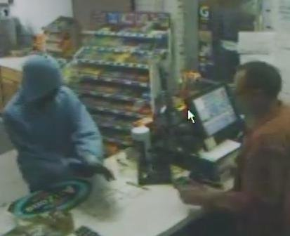 This image from a security camera at the Petrol gas station on Route 9W in Glenmont shows a man police said robbed the store by displaying a handgun. Police are asking for the public's help in locating the man.
